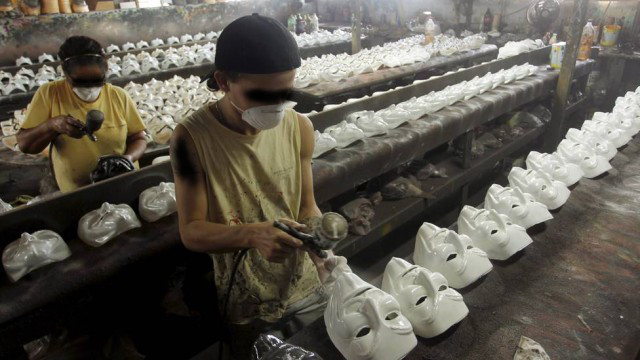 anonymous mask being created in sweatshop